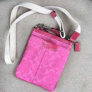 Pink small crossbody COACH bag.